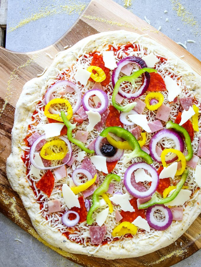 Italian Sub Pizza is topped with all the ingredients and is about to be baked.