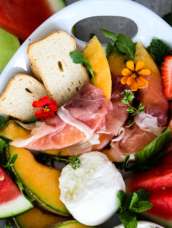 Procuitto is wrapped around canteloupe on the Italian Summer Melon and Cheese Board.