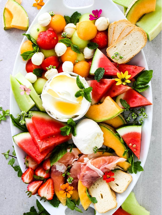 Italian Summer Melon and Cheese Board is plated on a large white serving platter.