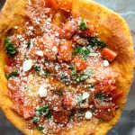 Deep Fried Neapolitan Pizza is baked and topped with sautéd tomatoes, basil and parmesan cheese.