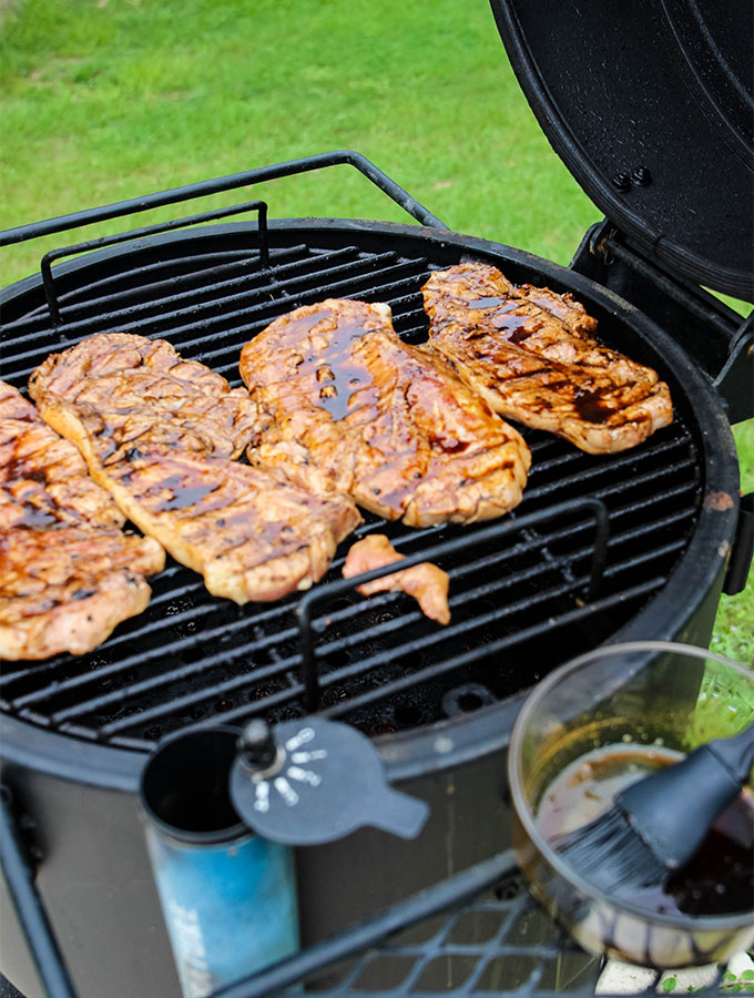 Grilled Sweet Tea Pork Chops are thrown on the grill and glazed with a sweet tea glaze.