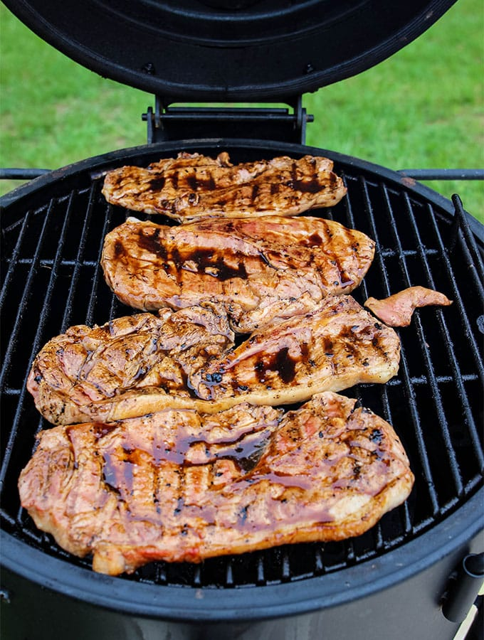Grilled Sweet Tea Pork Chops are thrown on the grill and cooked to 160 degrees.