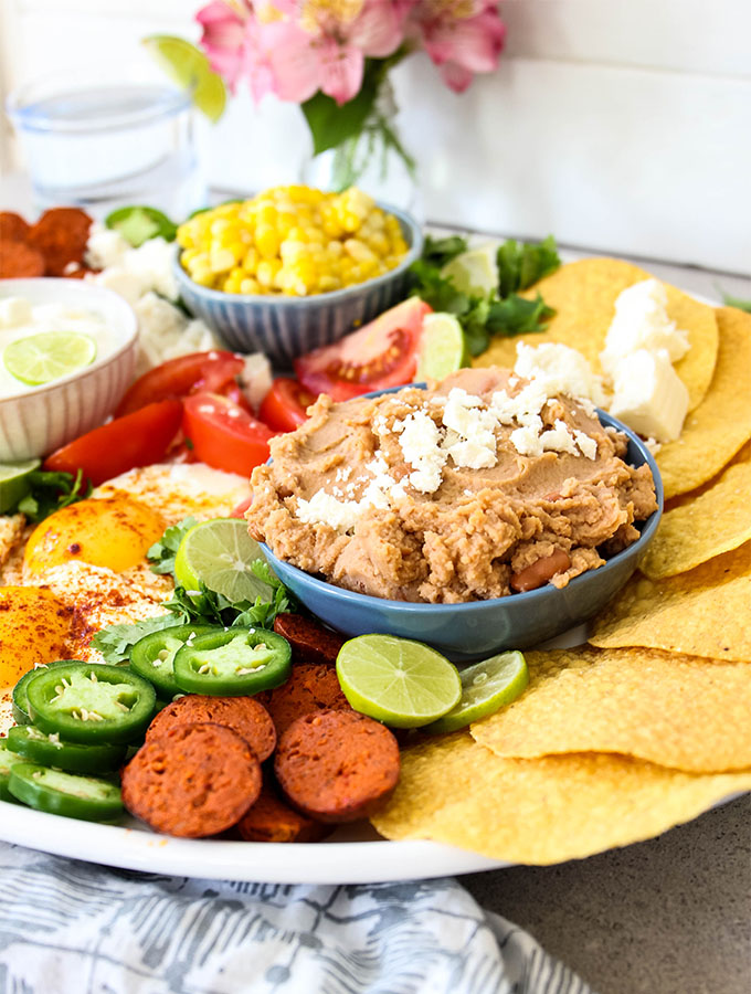 Mexican Tostada Breakfast Board is loaded with chorizo sausage, jalapenos, and tomatoes.