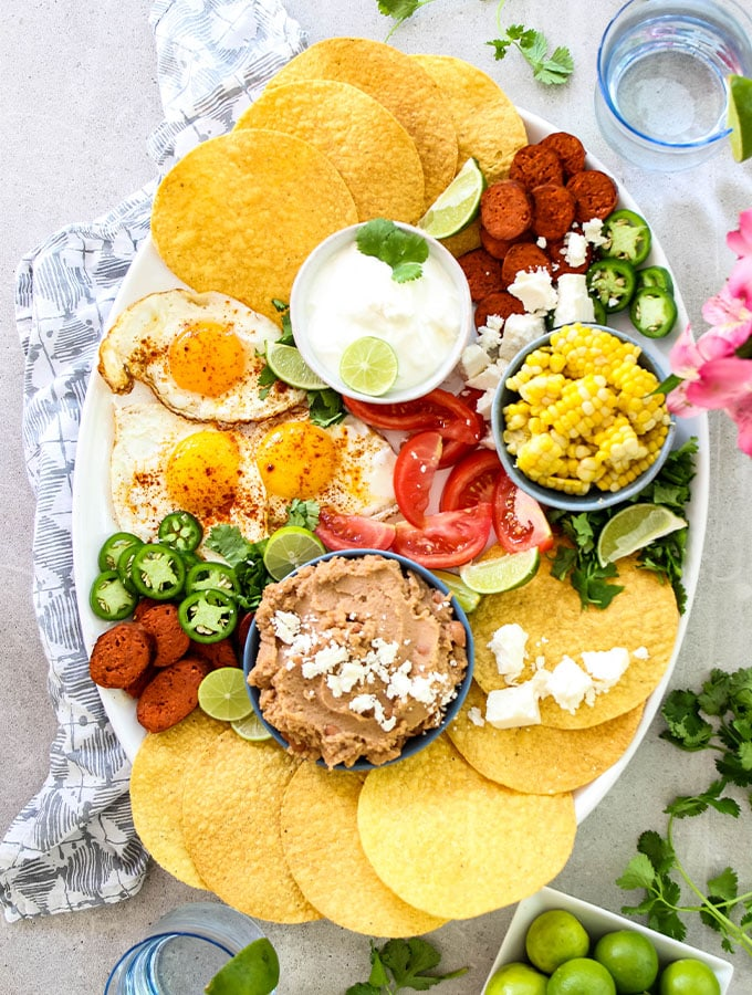 Mexican Tostada Breakfast Board is made with tostadas, chorizo sausage, refried beans, and more fresh ingredients.