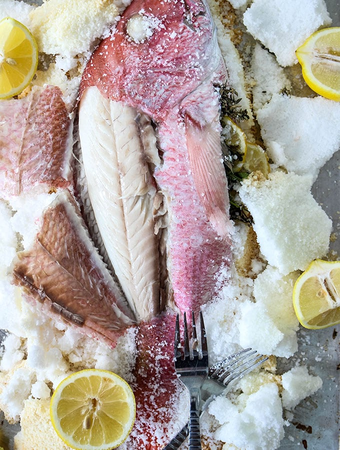 Salt Crusted Fish is served with lemon wedges to add more flavor.