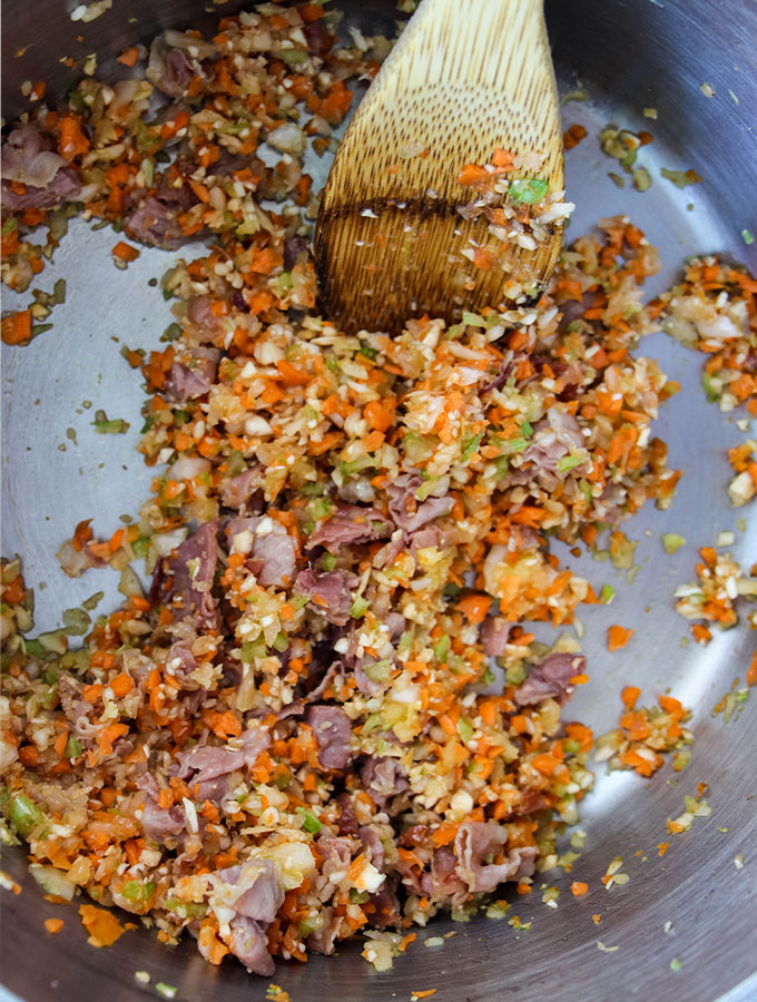 Vegetables are sautéd with prosciutto to make Authentic Bolognese Sauce (Salsa Bolognese).