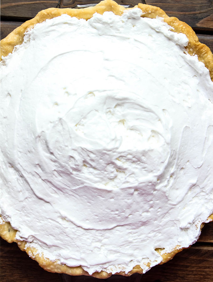 The key lime pie is topped with meringue before it's baked.