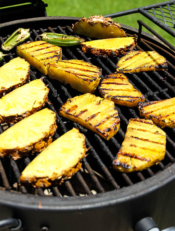 Pineapples are grilled on a hot grill to make Grilled Pineapple Jalapeño Margaritas.