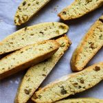 Orange Pistachio Biscottis are played on parchment paper after they are baked.