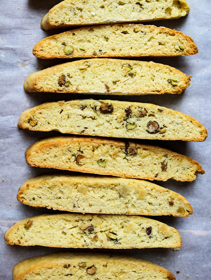 Orange Pistachio Biscottis are cut, then placed on their side.