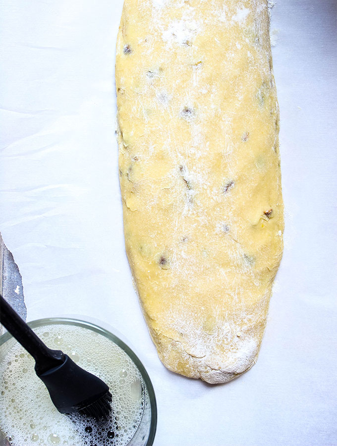 A loaf of Orange Pistachio Biscotti dough is shaped into a log before it is baked.