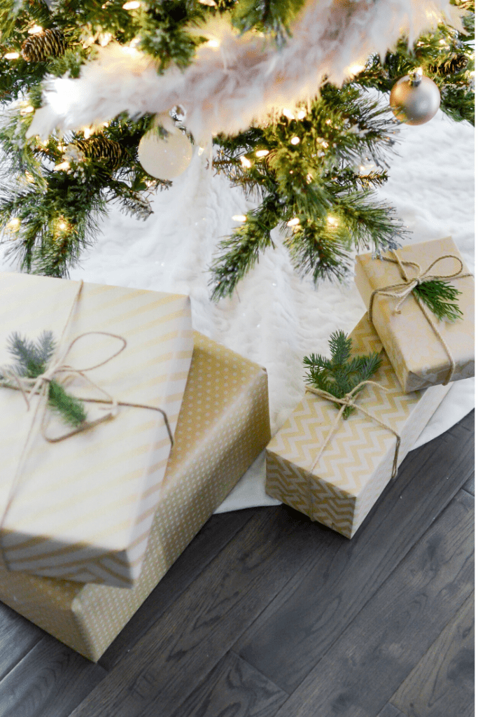 Wrapped presents are set under the tree for a Christmas in July celebration.