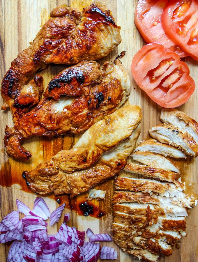 Chicken, red onion, and tomato are prepared for the quesadillas.