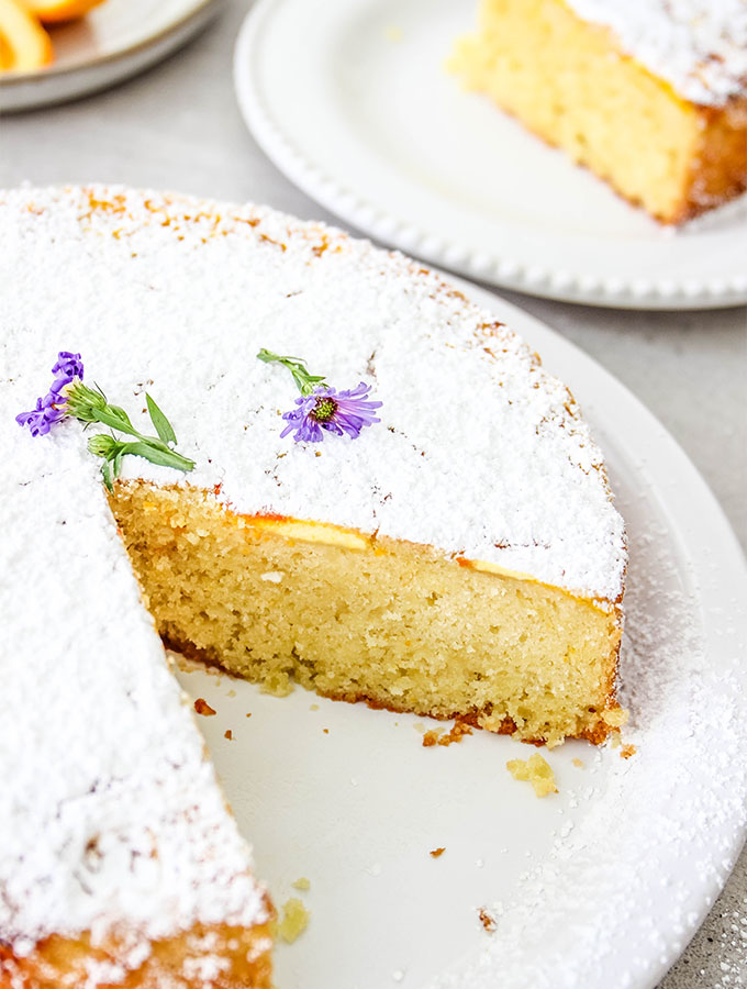 Easy Italian Olive Oil Cake is sliced and plated.