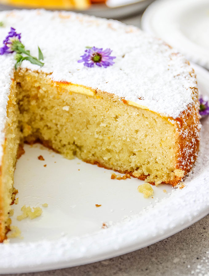 Easy Italian Olive Oil Cake is sliced to show the dense texture.