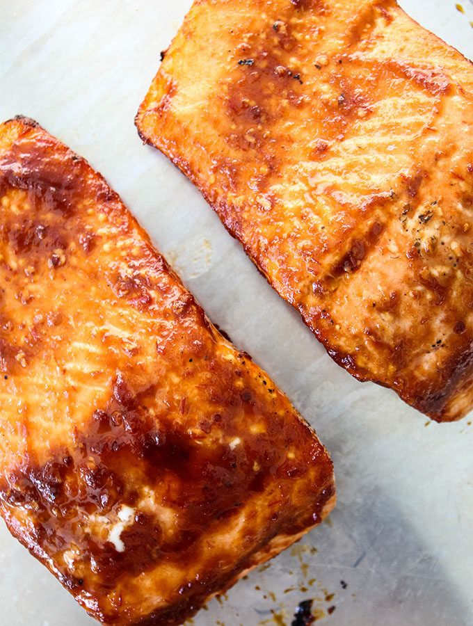 Grilled Bourbon Glazed Salmon is plated after it was glazed and grilled.