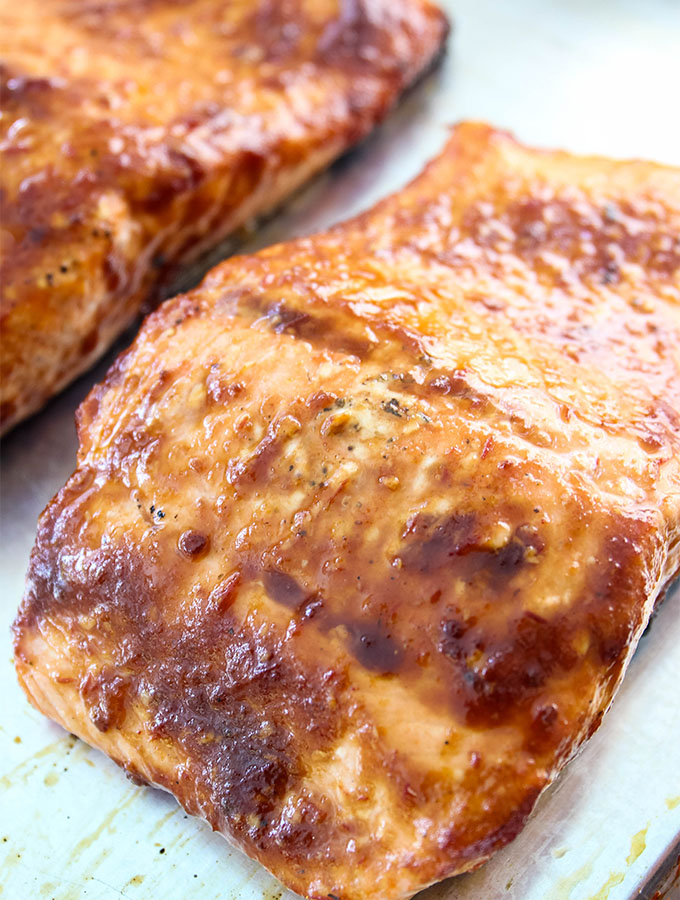 Grilled Bourbon Glazed Salmon is plated after it's grilled and slathered with BBQ sauce.