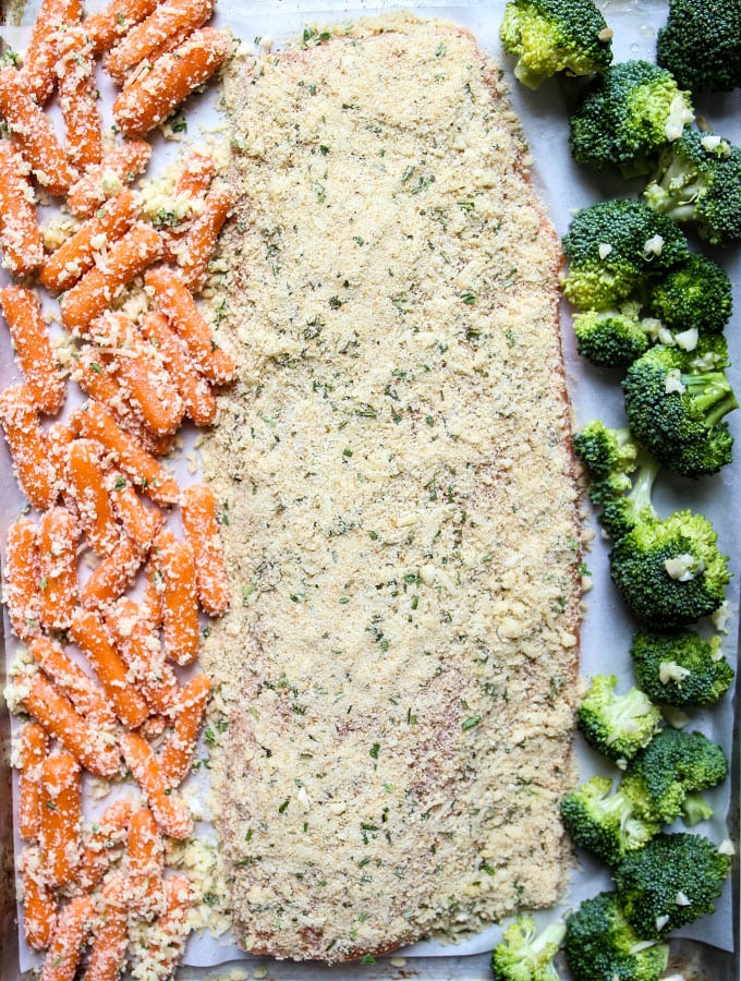 Salmon is cooked on the same sheet pan with the broccoli and carrots for an easy and fast meal.