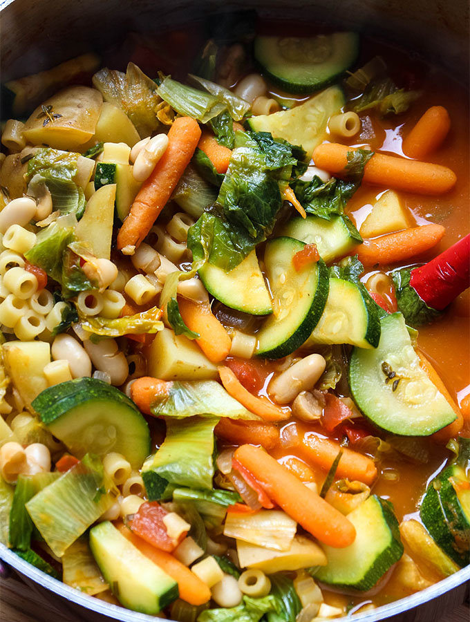 Minestrone soup is made in one large soup pot and stirred with a rubber spaulta.