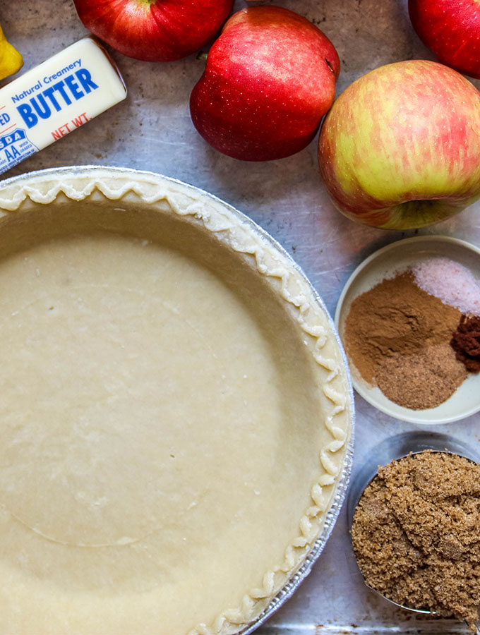 The Dutch apple pie ingredients are displayed individually, like apples, pie crust, butter, sugar, and spices.