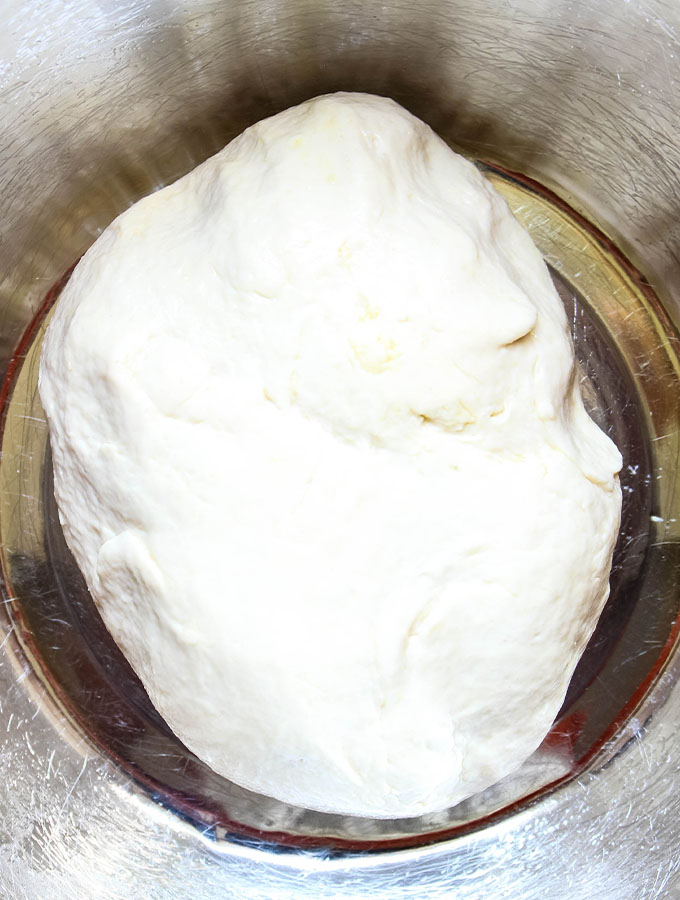 The French bread roll dough is placed in an well oiled bowl so it can rise.