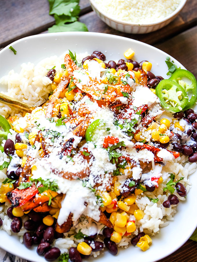 Cotija cheese tops the fajita vegetable rice bowls for added flavor and texture.