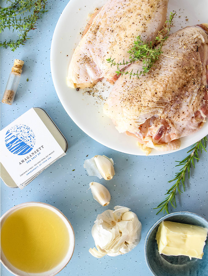Chicken and white wine pan sauce ingredients are displayed individually on a baking sheet.