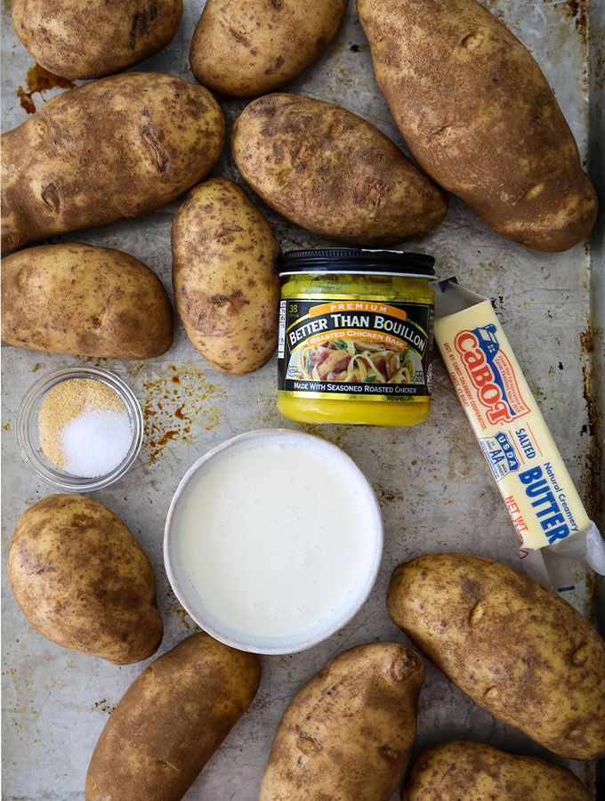 Potatoes, butter, seasoning, heavy cream, and chicken boullioun are displayed individually.