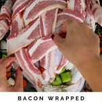 A hand is weaving bacon on a raw turkey.