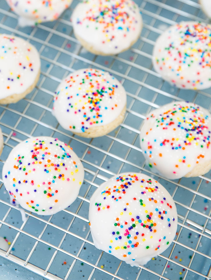 Italian anise cookies are placed on a wire rack so the sugar glaze can harden.
