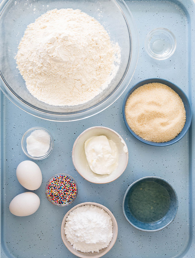 Italian cookies are made with simple ingredients like oil, eggs, sour cream, flour, and a few more.