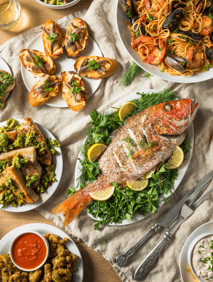 Feast of the Seven Fishes is an Italian tradition that includes 7 dishes of seafood on Christmas Eve.