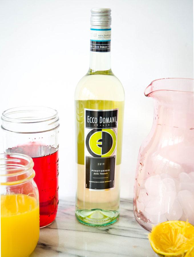 Cranberry orange sangria ingredients include wine, orange juice, pineapple juice, and cranberry juice.