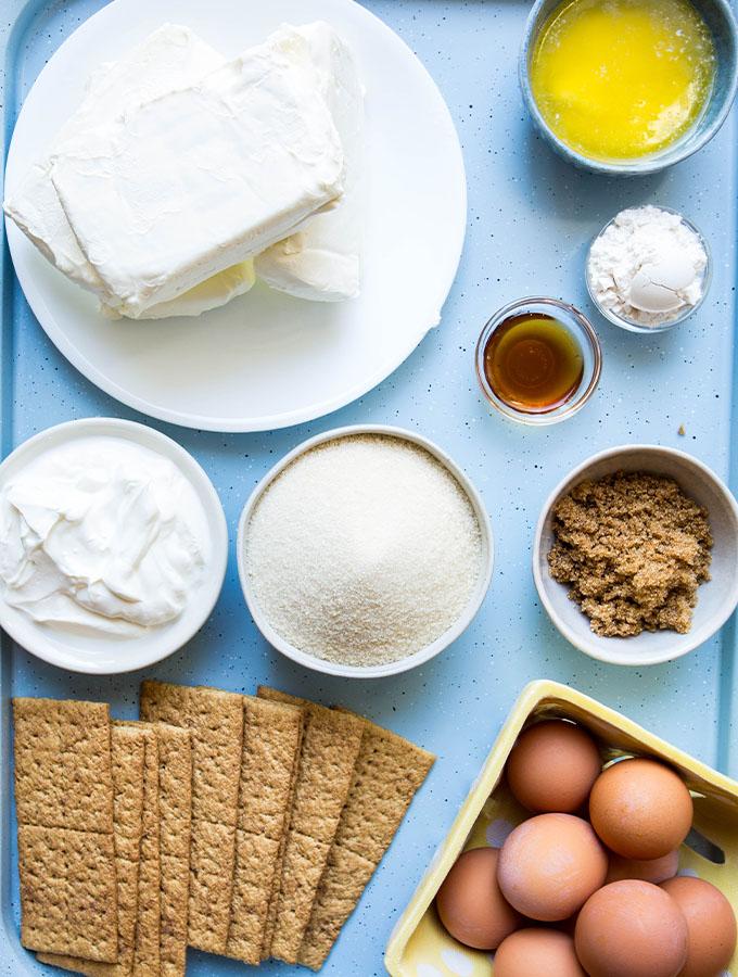 Cheesecake ingredients are displayed individually like cream cheese, sugar, sour cream, etc.