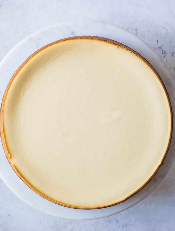 The cheesecake is baked and refrigerated so the filling has time to set.