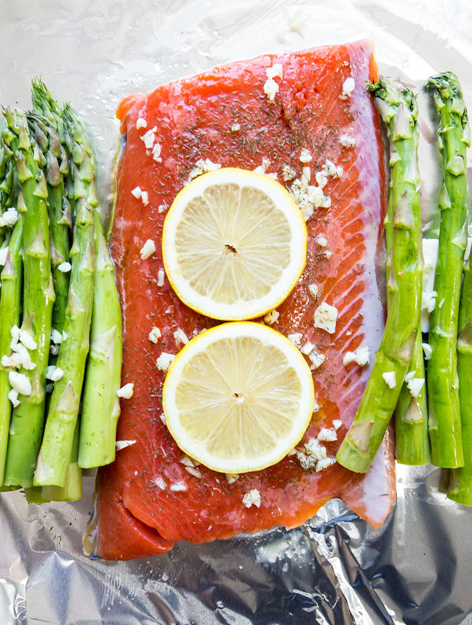 Salmon, lemon, and asparagus is wrapped in foil and cooked in under 20 minutes.