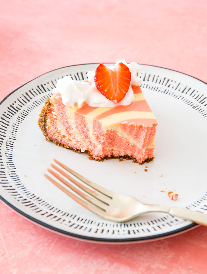 A slice of cheesecake is plated and eaten to show to fluffy texture.