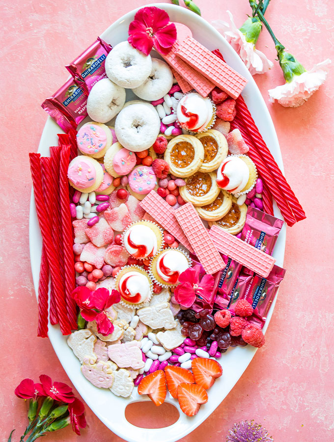 Valentine's day treats are plated on a charcuterie board.