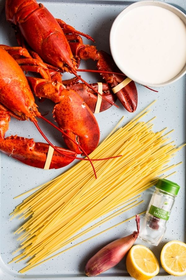 Lobster pasta with saffron cream sauce ingredients are displayed individually.