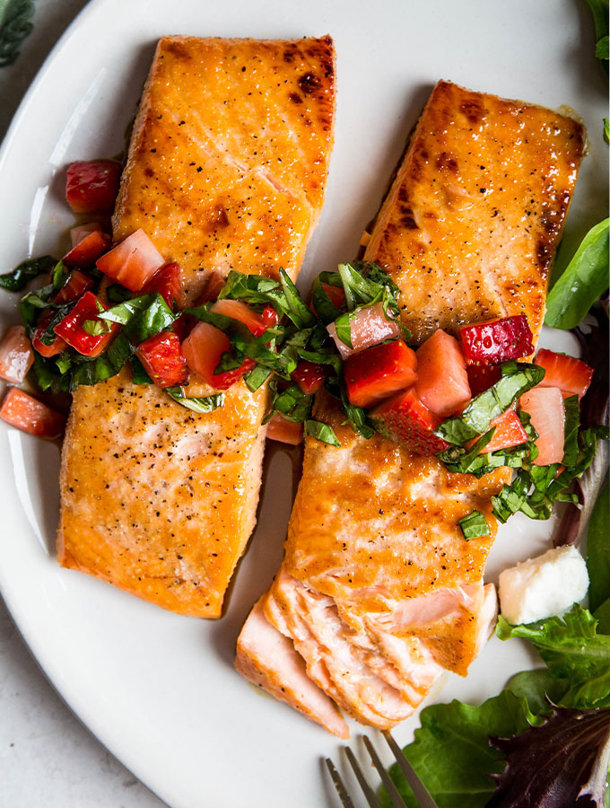 A salmon fillet is flaked to show the tender, juicy texture.