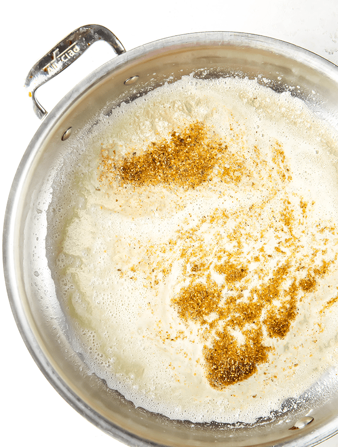 Butter is melted in a pan, then spices are added to liven up the flavor.