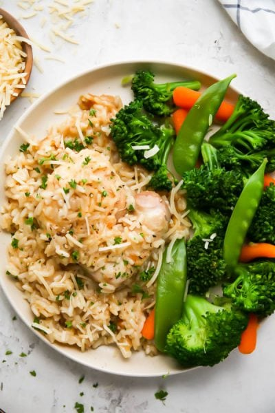 Chicken casserole is plated on a plate with a vegetable melody.
