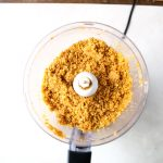 The vanilla wafer crust is blended in a food processor with melted butter.