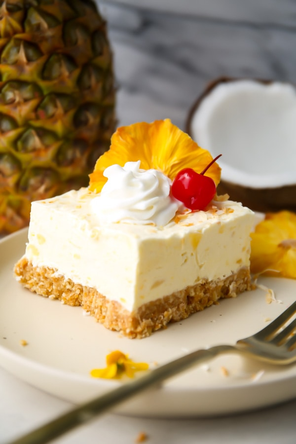 No bake cheesecake is placed on a plate with vanilla wafers.