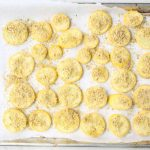 The summer squash is sliced, tossed in breading, and roasted in the oven.