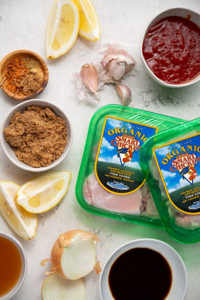 Organic boneless skinless chicken thighs and BBQ sauce ingredients are displayed individually.