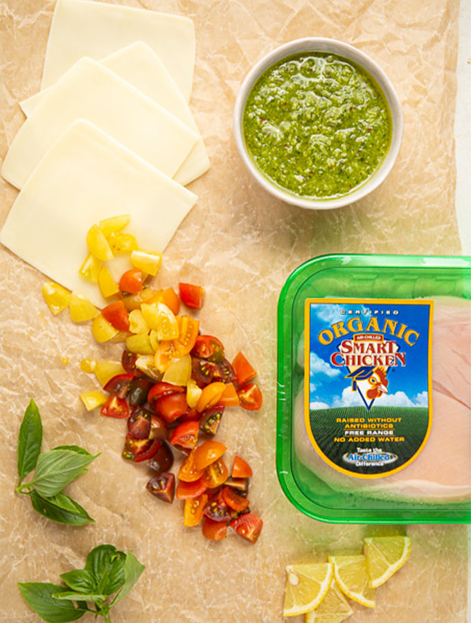 Chicken Margherita is made with Smart Chicken chicken breasts, tomatoes, cheese, pesto, and basil.