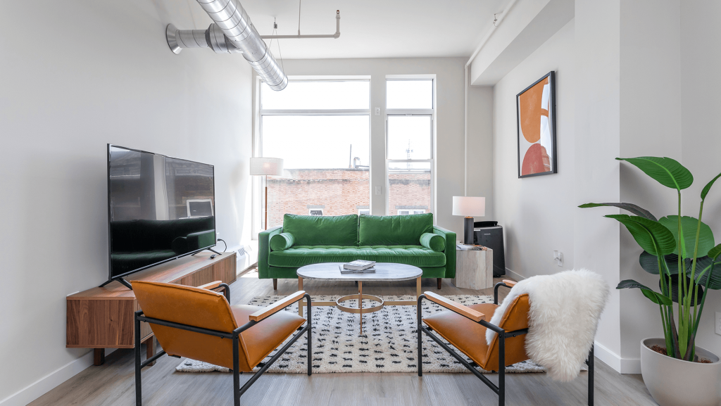 The living room is open concept with a large floor to ceiling window.